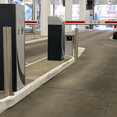 Fixed design stainless steel bollards in a car parking
